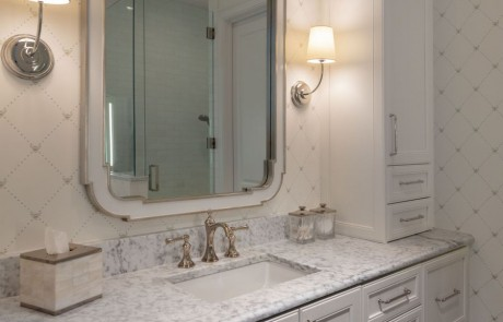 Second story transitional bathroom addition features custom white vanity with shaker cabinets, quartz countertops with undermount sink, polished nickel fixtures and wall sconces, white vanity mirror and Carrera Bianco marble floor.