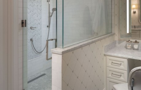 Second story bathroom addition includes a frameless walk-in shower with hinged door, white marble tile walls with gray mosaic accent tile wall, polished nickel fixtures, separate make up vanity with quartz countertops and Carrera Bianco marble floor.