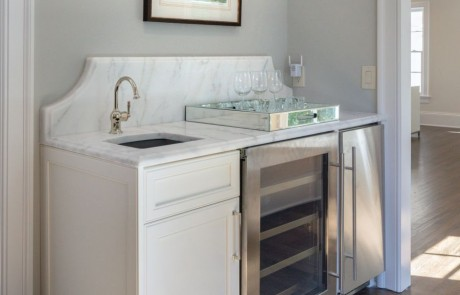 Master suite with custom coffee station and wet bar, white quartz countertops, wine storage, under counter refrigerator, ice maker and undermount bar sink with polished nickel faucet.