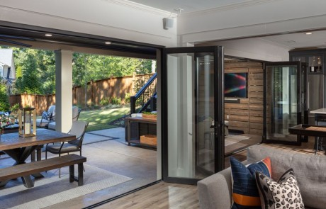 Black Panoramic Doors open the entire width of the basement and create an instant Indoor/Outdoor connection for entertaining.