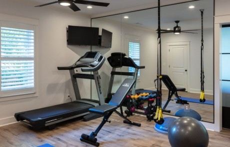 Basement with Private Home Gym and Floor to Ceiling Mirrored Walls.