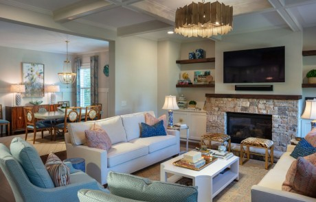 Transitional, blue and white, open concept family room and dining room with stone fireplace and mounted tv, custom built ins, coffered ceilings, designer décor and contemporary lighting.